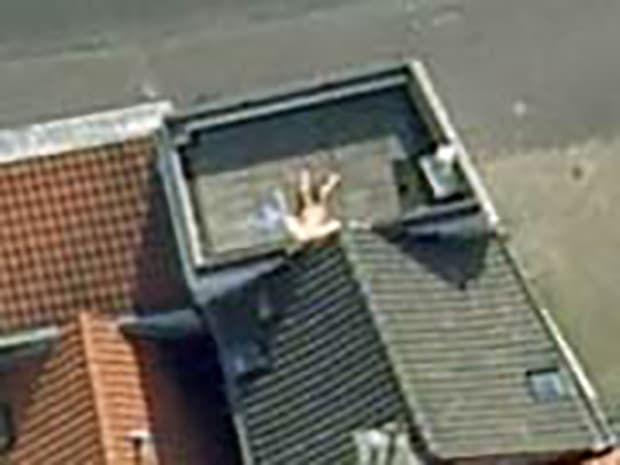 Naked Rooftop Sunbather
