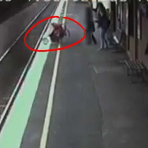 OMG - Baby Stroller Rolls into Path of Oncoming Train