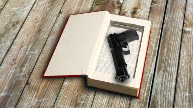 Gun Hidden Inside A Hollowed Out Book