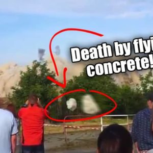 Flying Debris Almost Kills Spectators During Building Demolition