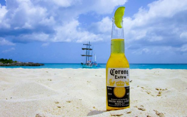 Corona Beer Bottle On A Beach