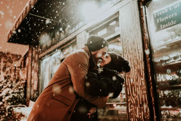 Couple Kissing in The Snow