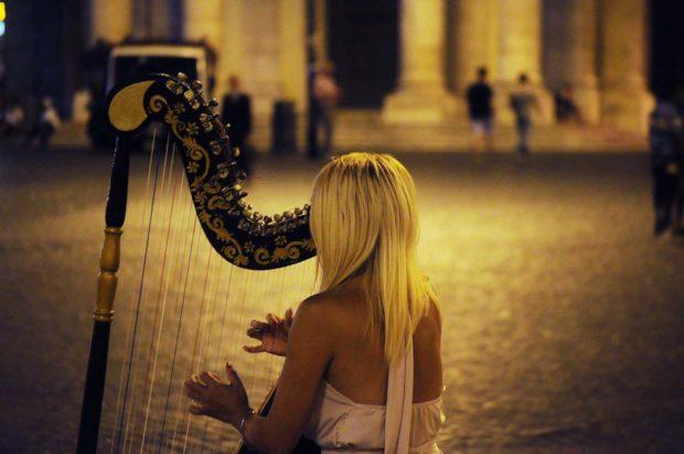 Irish Woman Playing The Harp