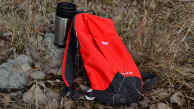 Red Hiking Backpack And Coffee Mug