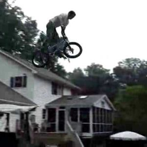 Insane BMX Jump Over A Fence and Into A Swimming Pool