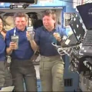 Astronauts Celebrate New NASA Urine Recycler WIth A Bag Of Recycled Urine
