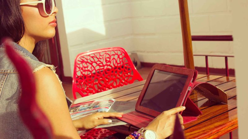 Woman Using A Refurbished iPad