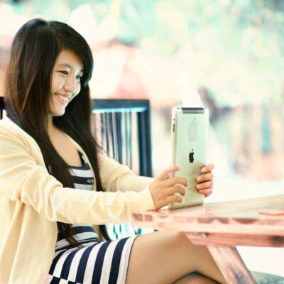 Happy Woman Using an iPad