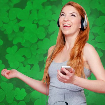 Happy Woman Listening To Irish Music