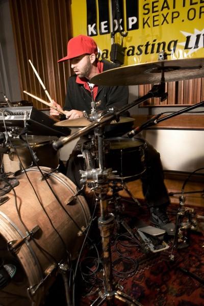 Kotchy playing drums at KEXP