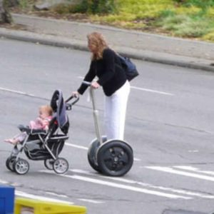 Lazy Segway Mom Dangerously Pushes Baby Stroller