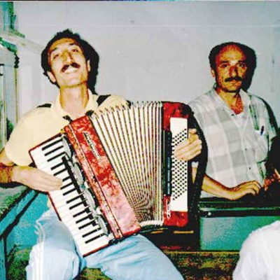 Mahir Playing An Accordion