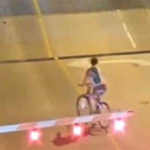Whoopsie! Cyclist Ignores Drawbridge Warning Gates And Falls Into Gap
