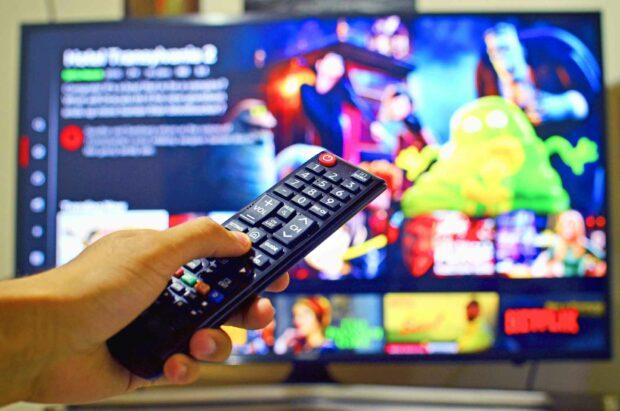 Man Using A Smart TV