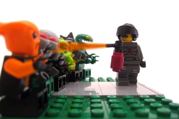 Pepper Spray Meme: A LEGO Lt. John Pike using pepper spray on peaceful LEGO protesters.