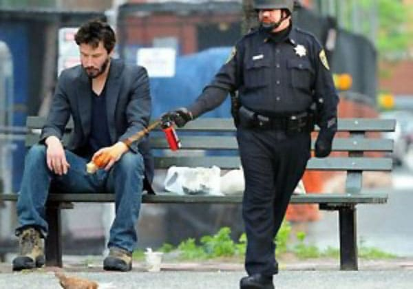 Lt. John Pike using pepper spray on Sad Keanu Reeves