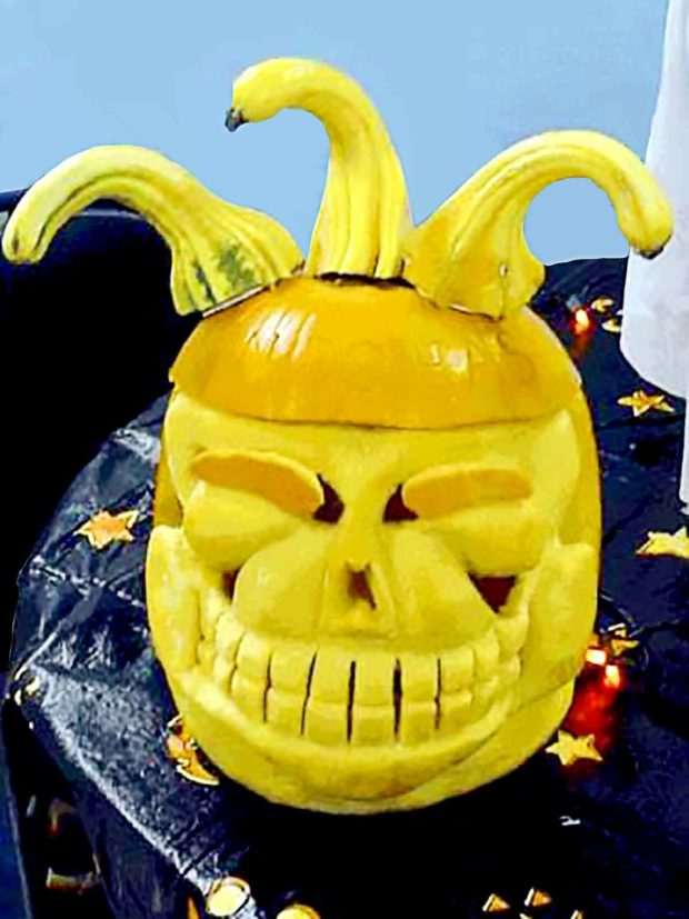 Creepy Skull Face Pumpkin With A Jester Hat