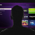 Man Watching A Roku Connected TV Device