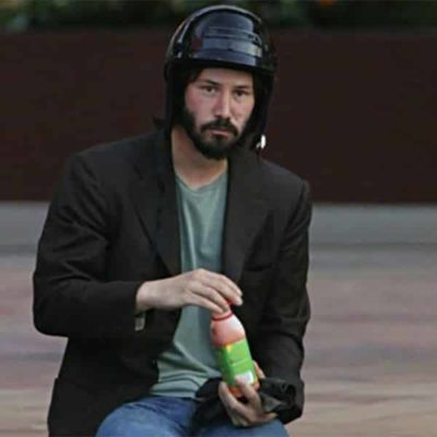 Sad Keanu Reeves With Helmet And Juice